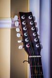 Headstock гитары на предпосылке стены Стоковая Фотография RF