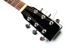 Headstock of acoustic guitar. Headstock of acoustic black guitar close up Royalty Free Stock Photography