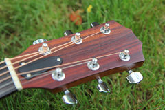 Headstock of acoustic guitar Stock Images