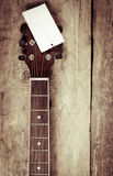 Headstock of acoustic guitar. On wooden background Stock Photos
