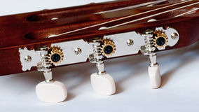 Headstock of classical guitar close up Stock Photos