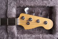 Headstock of the electric Bass guitar in fur hard case Royalty Free Stock Photos