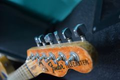 Fender Telecaster. Headstock of electric guitar, silver tuning knobs Royalty Free Stock Photo