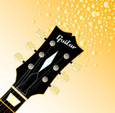 Headstock Fizz. A traditional guitar headstock with strings and tuners giving of golden fizz Royalty Free Stock Photography