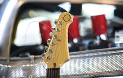 Headstock of the six string classic electric guitar on blurred background Royalty Free Stock Photo