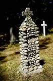 Headstone. A closeup of an interesting, narrow headstone, made from many pebbles. Taken on a sunny day in a graveyard stock photography