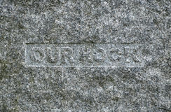 Headstone. Gray granite headstone engraving - OUR ROCK Stock Image
