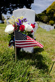 Headstone and American Flag at National Cemetery Stock Photography