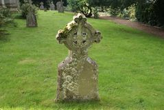 Headstone with a celtic cross in a cemetery. Royalty Free Stock Images