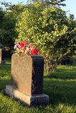 Headstone with flowers Stock Images