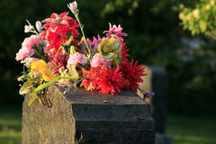 Headstone with flowers Stock Photography