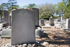 Headstone in Jewish Cemetery with Star of David and Memory Stone Stock Photos