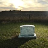 Headstone marking rural grave. Stock Image