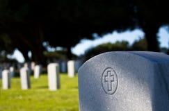 Headstone in morning sunlight Stock Photo