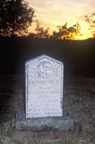 Headstone at sunset Stock Image
