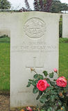 Headstone of unknown British WW1 soldier of Gloucestershire Regiment in military cemetery in France Royalty Free Stock Photo