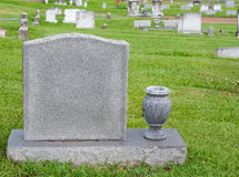 Headstone and vase. In a cemetery Royalty Free Stock Image