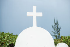 Headstone with white cross. Stock Image