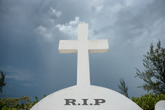 Headstone with white cross and RIP Royalty Free Stock Photo
