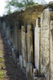 Headstones. Propped up against the stone wall of a church. Not sure why royalty free stock photos