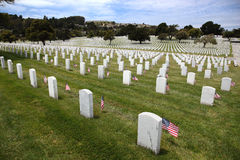Headstones and Flags at National Cemetery Stock Photography