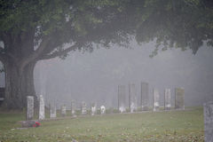 Headstones in the Mist. Old headstones on a foggy day royalty free stock photography