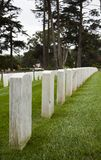 Headstones. A row of headstones in a cemetery stock photo