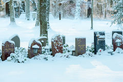 Headstones in snow Royalty Free Stock Images