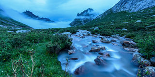 Headstream of clouds. High Altitude ravine stream above the clouds royalty free stock photography