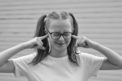 Free Headstrong Pretty Kid, Teen Age Girl, Being In Great Mood And Showing Her Smile And Long Hair Tails. Black And White Image Royalty Free Stock Photos - 155292058