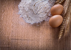 Heaf of four eggs corolla wheat ears on wooden Stock Images