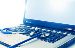 Heal the laptop. Old laptop with a statoscop royalty free stock images