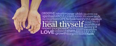 Heal Thyself Word Cloud. Female hands in cupped position on a deep blue and magenta swishing energy background with a white HEAL THYSELF word cloud to the right royalty free stock photography