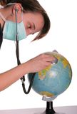 Heal the world. Doctor examine with stetoscope the ill Earth Royalty Free Stock Image