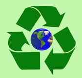 Heal the world by recycling. Recycle sign with planet Earth inside Royalty Free Stock Photography