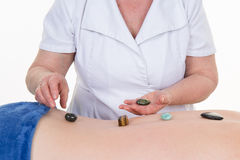 Healer unblock her patient's energy centers. Royalty Free Stock Photography