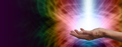 Healer with vibrant healing energy. Website banner for a color healer showing female hand holding shaft of healing light on vibrant web-like rainbow colors and stock photos