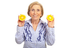 Healhty senior woman holding orange Stock Images