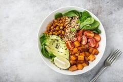 Healhty vegan lunch bowl. Avocado, quinoa, sweet potato, tomato, Royalty Free Stock Photo