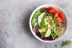 Healhty vegan lunch bowl. Avocado, quinoa, tomato, cucumber, red royalty free stock images