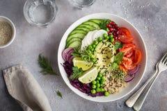 Healhty vegan lunch bowl. Avocado, quinoa, tomato, cucumber, red stock photos