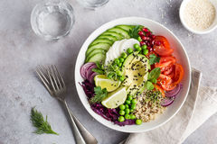 Healhty vegan lunch bowl. Avocado, quinoa, tomato, cucumber, red Royalty Free Stock Photography