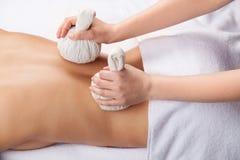 Healing back massage. Royalty Free Stock Images