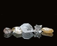 Healing Crystals on Black Background. Five Healing Crystals on a reflective black background Royalty Free Stock Image