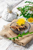 Healing dandelion root. National therapeutic agent from a flower and dandelion root royalty free stock photos