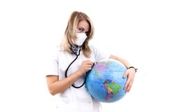 Healing the Earth. Earth with a stethoscope..isolated on white Royalty Free Stock Photo