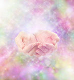 Healing energy and sparkles. Misty colorful sparkling soft energy and cupped healing hands Stock Photography