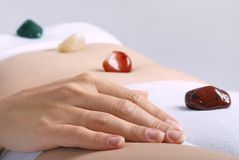 Healing by gems laid on body chakras Stock Images