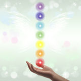 Healing Hand and seven chakras Stock Images