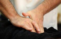 Healing hands. The healing hands of an osteopath Stock Photos